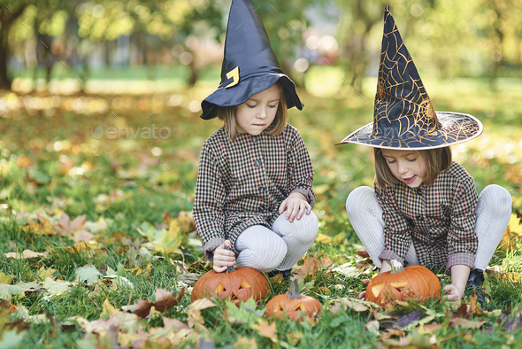 Twins in witch costume during Halloween time - Stock Photo - Images