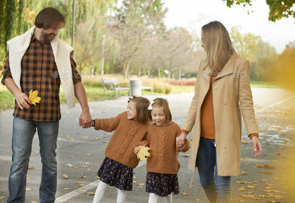 Happy family in actively spending time - Stock Photo - Images