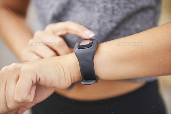Woman checking how many calories she burned - Stock Photo - Images