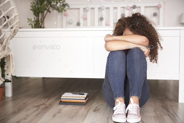 Depressed teenage girl in her room - Stock Photo - Images