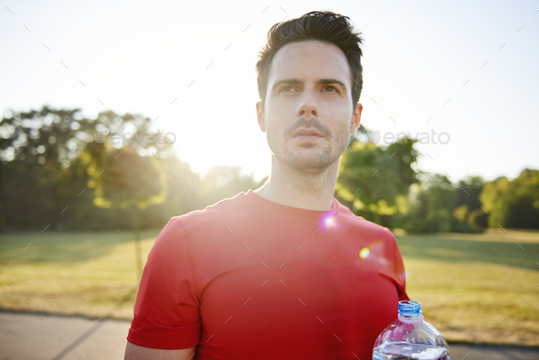 Young man drinking water after hard workout - Stock Photo - Images