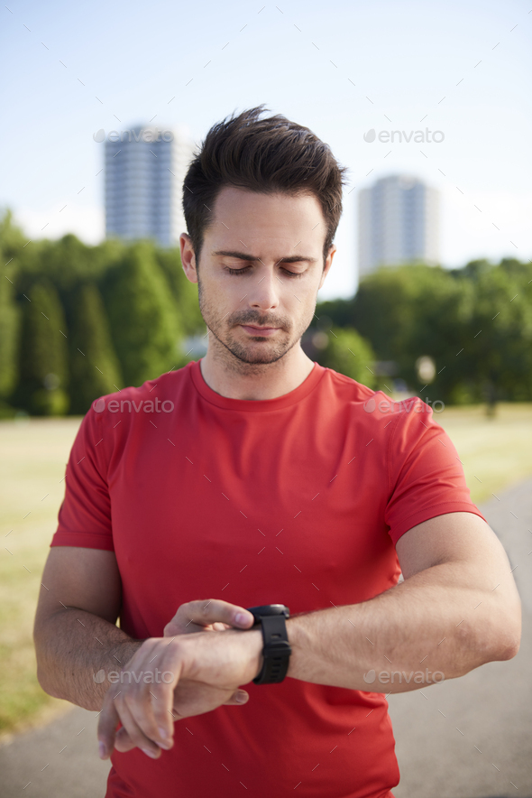Man checking how many calories he burned - Stock Photo - Images
