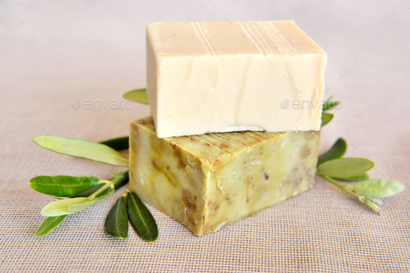 Handmade soap bars and olive branches on gunny background - Stock Photo - Images