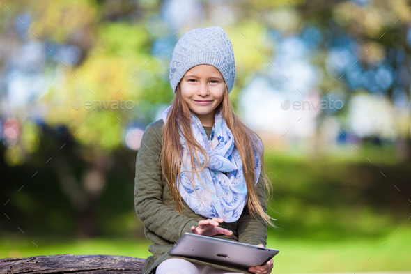 Portrait of little girl at beautiful autumn day outdoors - Stock Photo - Images