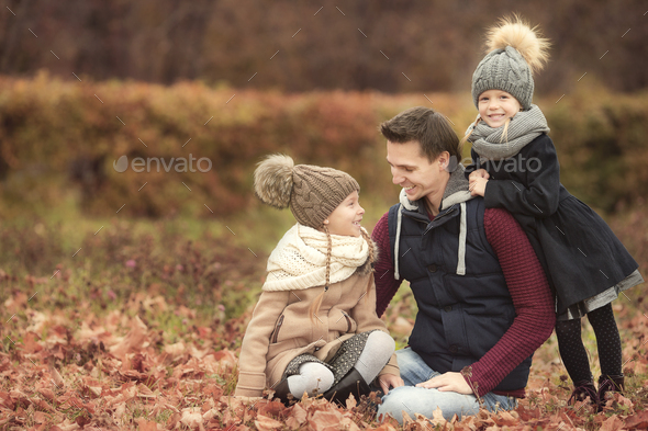 Happy family in autumn park outdoors - Stock Photo - Images