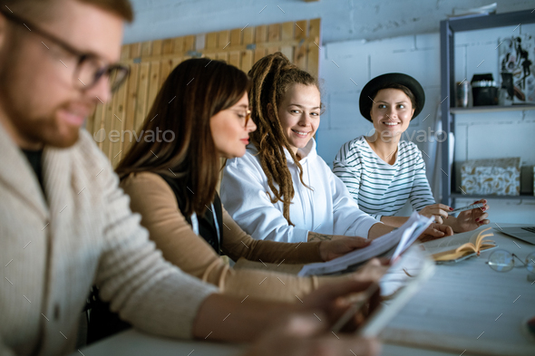 Happy young creative designers coming up with new creative ideas - Stock Photo - Images