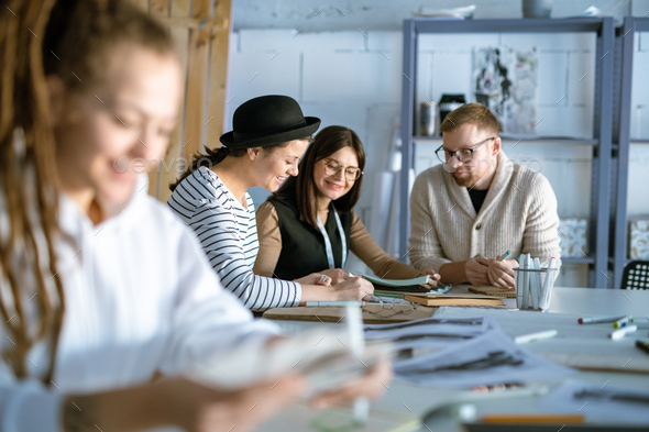 Group of happy young designers or students discussing creative ideas - Stock Photo - Images