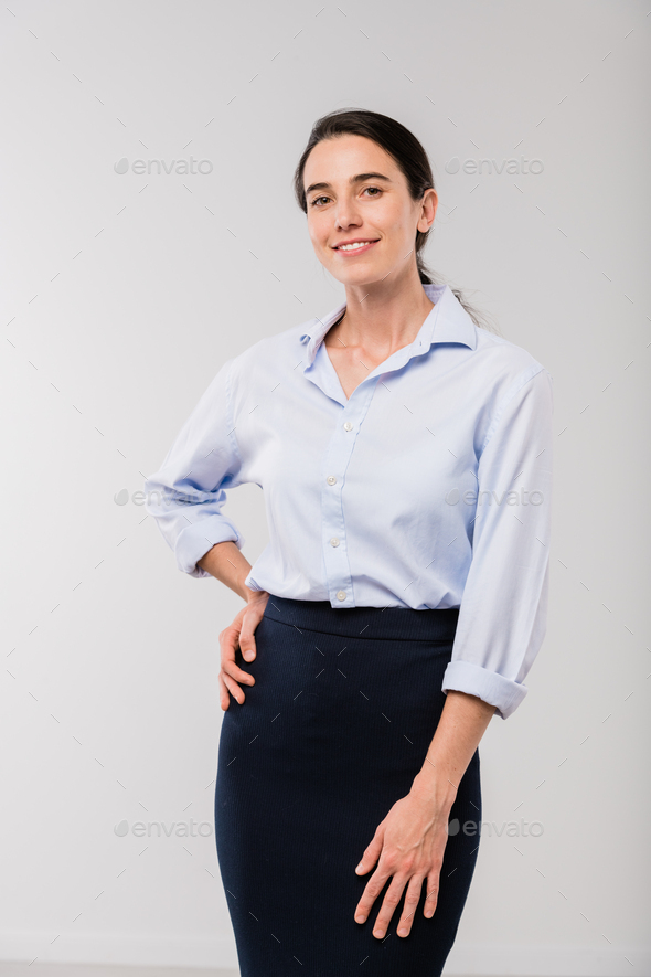 Happy young elegant businesswoman in white shirt looking at you in isolation - Stock Photo - Images