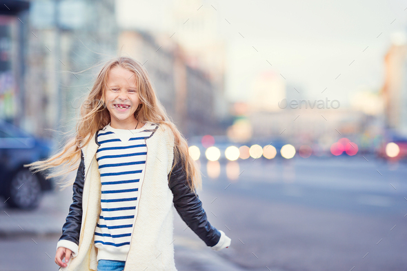 Adorable fashion little girl outdoors in European city - Stock Photo - Images
