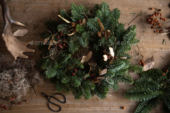 Woman making Christmas wreath of spruce, step by step. - Stock Photo - Images