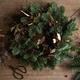 Woman making Christmas wreath of spruce, step by step. - PhotoDune Item for Sale