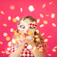 Fancy girl blowing confetti against pink bakground - PhotoDune Item for Sale