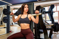 Young professional female athlete in sportswear sits in gym - PhotoDune Item for Sale