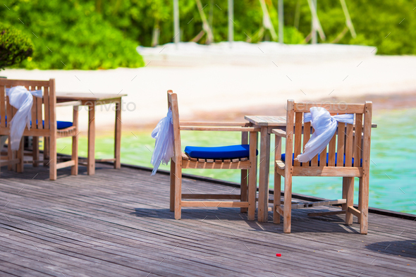 Summer empty outdoor cafe at beautiful tropical island - Stock Photo - Images