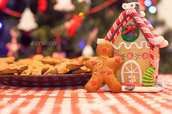 Cute gingerbread man and candy ginger house background Christmas tree lights - Stock Photo - Images