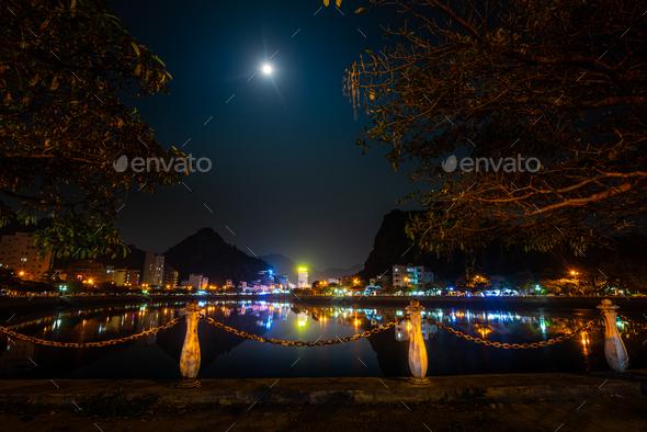 Full moon over Cat Ba Vietnam City at night - Stock Photo - Images