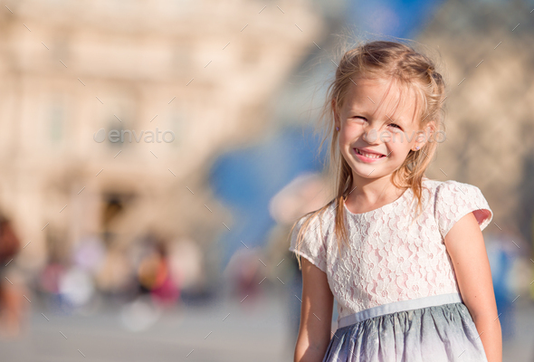 Adorable little girl during summer vacation in Paris - Stock Photo - Images