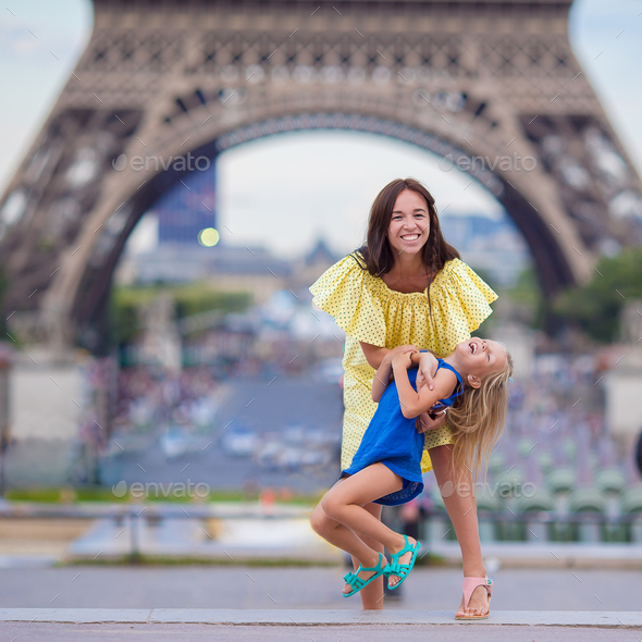 Happy family in Paris near Eiffel Tower during summer french vacation - Stock Photo - Images