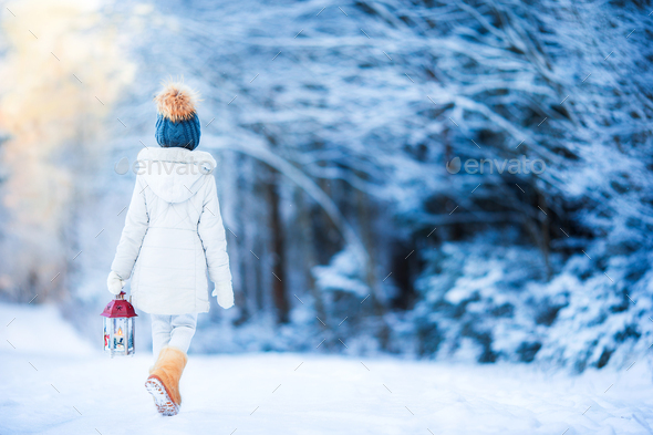 Adorable little girl with flashlight in winter on Christmas outdoors - Stock Photo - Images