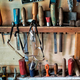 Several chisels, hammer, and other tools hanging in wooden wall - PhotoDune Item for Sale