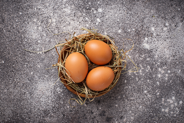 Fresh raw brown eggs in bowl. - Stock Photo - Images