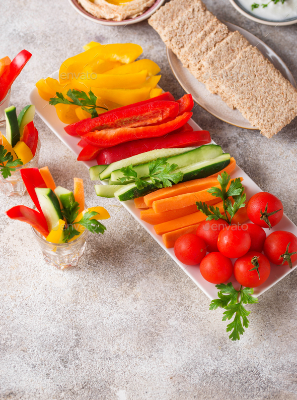 Healthy snacks. Vegetables and hummus - Stock Photo - Images