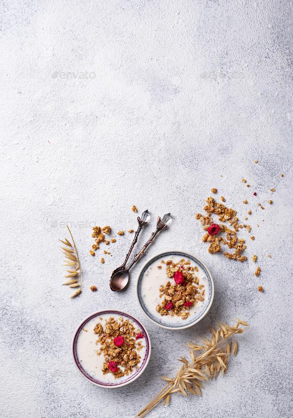 Granola with yogurt and dried raspberries - Stock Photo - Images