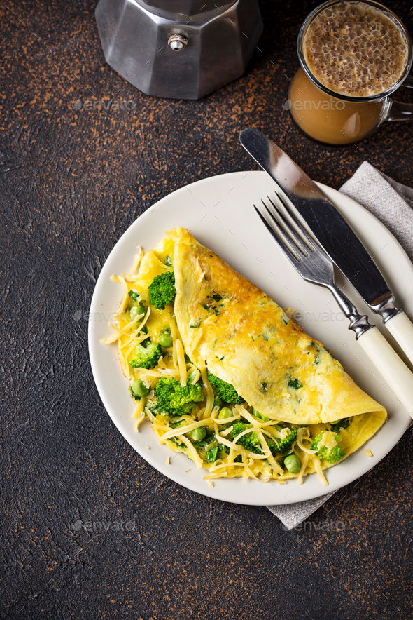 Omelette with green vegetable and cheese - Stock Photo - Images