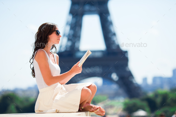 Beautiful woman in Paris background the Eiffel tower - Stock Photo - Images