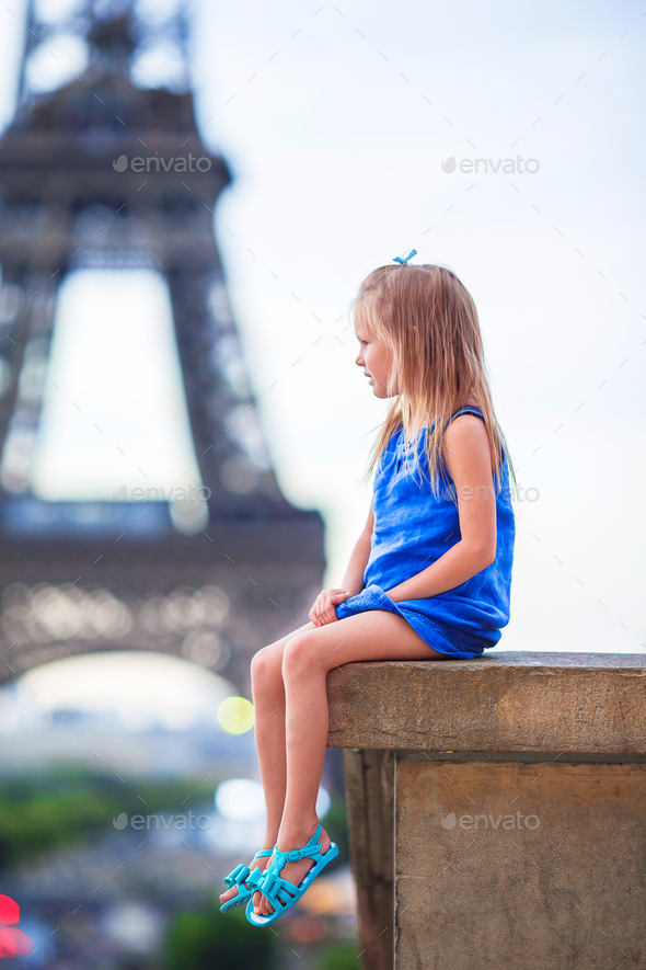 Adorable little girl in Paris background the Eiffel tower during european vacation - Stock Photo - Images