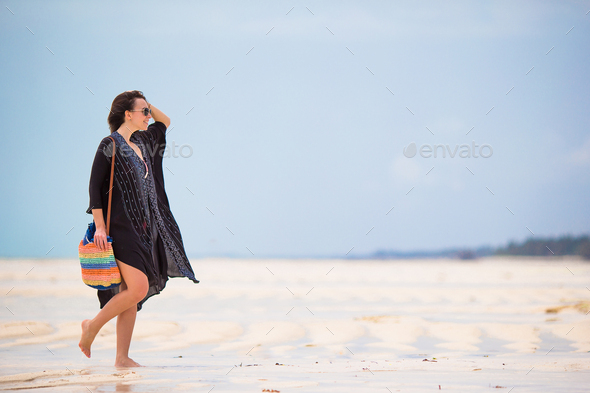 Young beautiful woman on beach vacation - Stock Photo - Images
