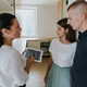Estate agent using digital tablet showing young couple new house. - PhotoDune Item for Sale