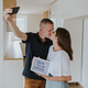 Young couple kissing and taking selfie in new house. - PhotoDune Item for Sale