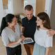 Estate agent with digital tablet showing young couple new apartment. - PhotoDune Item for Sale