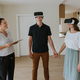 Estate agent with young couple wearing VR headsets in new apartment. - PhotoDune Item for Sale