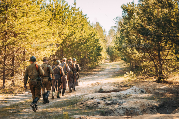 Group Of Re-enactors Dressed As Soviet Russian Red Army Infantry Soldiers Of World War II Marching - Stock Photo - Images