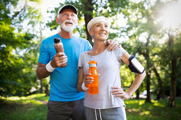 Active mature couple running in the park for helathy life - Stock Photo - Images