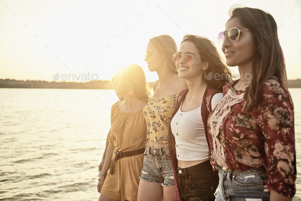 Four beautiful women on the beach - Stock Photo - Images