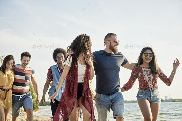 Group of joyful friends on the beach - Stock Photo - Images