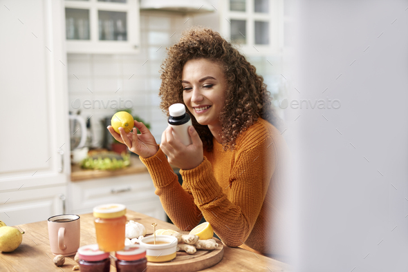 Young woman choosing proper protection - Stock Photo - Images
