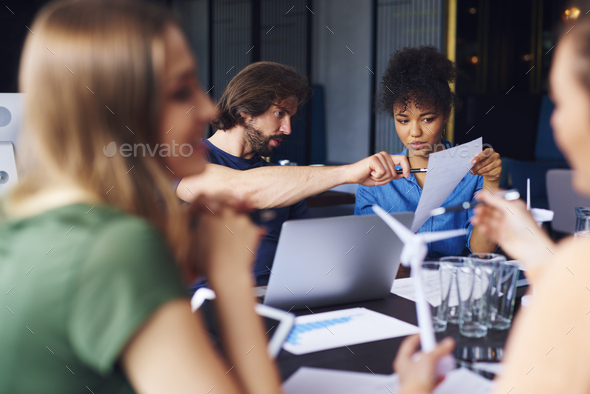 Couple analyzing the documents during business meeting - Stock Photo - Images