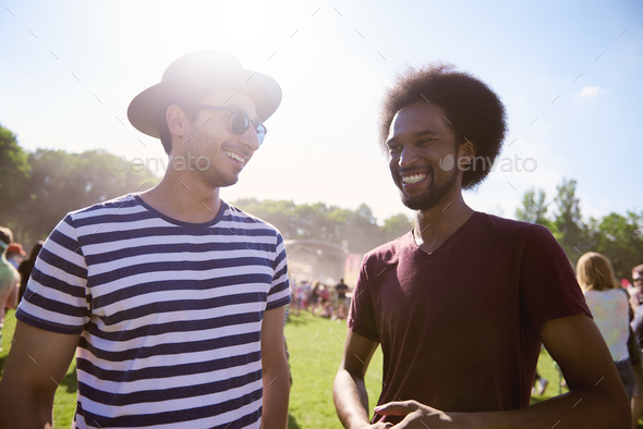 Happy men at the music festival - Stock Photo - Images