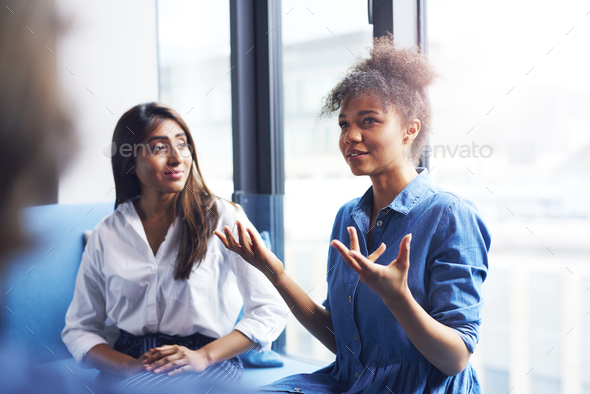 Two businesswomen in conference room - Stock Photo - Images
