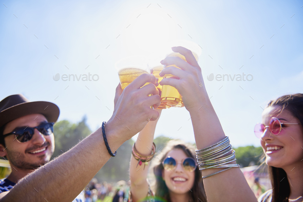 Friends drinking beer and having fun in festival - Stock Photo - Images