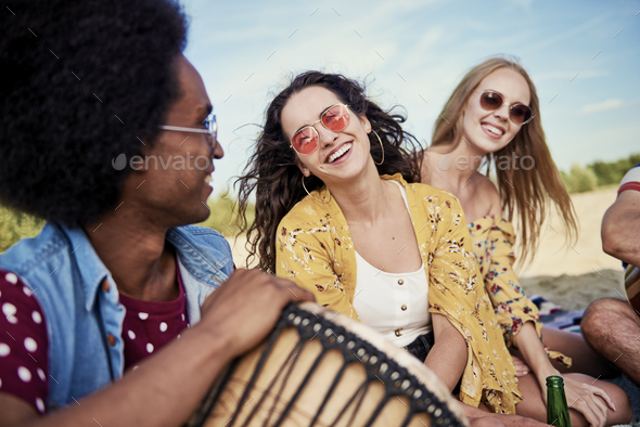 Party people having good time on the beach - Stock Photo - Images