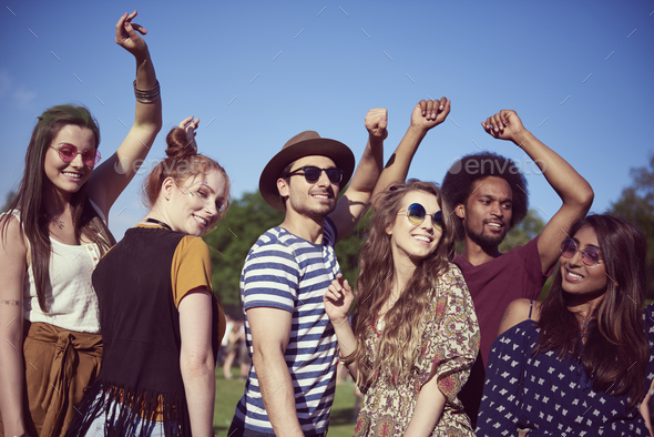 Happy friends dancing at the music festival - Stock Photo - Images