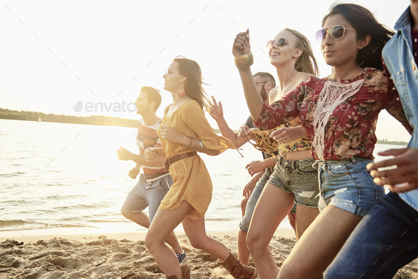 Picture of running people on the beach - Stock Photo - Images