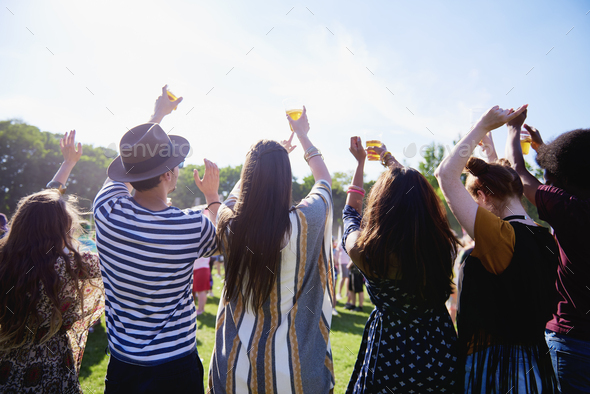Rear view of people having good time in festival - Stock Photo - Images