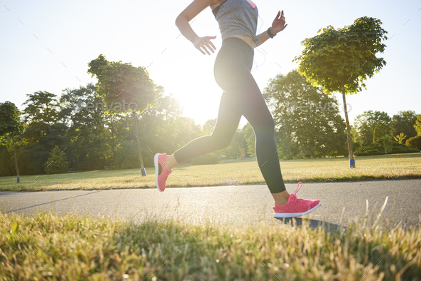 Low section of young woman running in the park - Stock Photo - Images