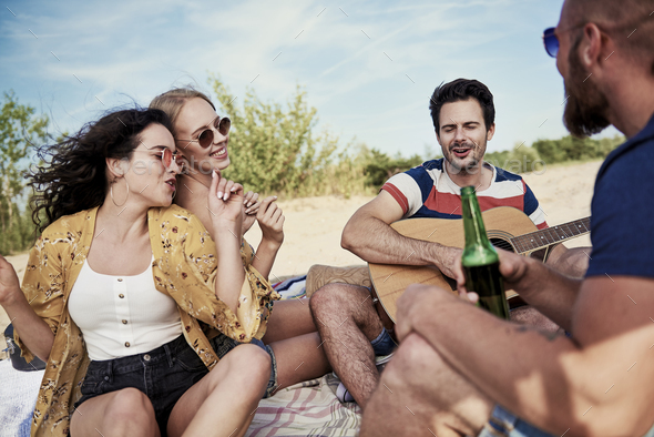 Friends having great fun on the beach - Stock Photo - Images